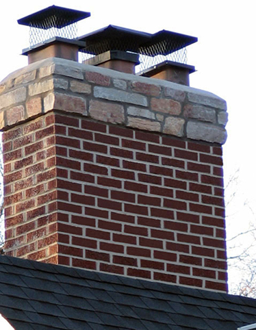 Brick Chimney with Stone Highlights